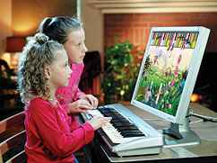 two girls playing piano